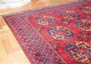 Sale 8562A - Lot 3 - A Caucasian carpet with geometric motif on red ground, 184 x 250cm
