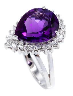 Sale 9037 - Lot 356 - AN 18CT WHITE GOLD AMETHYST AND DIAMOND RING; pear cut amethyst of approx. 3.7ct within a border of 24 round brilliant cut diamonds...
