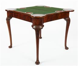 Sale 9123J - Lot 13 - An English Georgian antique walnut card table folding open onto concertina back legs. The figured walnut top opening to reveal the b...