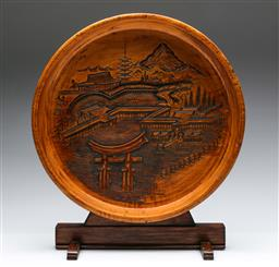 Sale 9173 - Lot 44 - A carved timber plate featuring village scene of Miyajima Island (Dia:35cm)