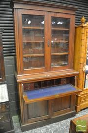 Sale 8335 - Lot 1023 - Edwardian Walnut Secretaire Bookcase, with two glass panel doors above a fitted fall front & two timber doors below