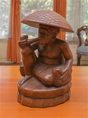 Sale 8375A - Lot 33 - A timber Filipino sculpture of a man smoking, H 25cm