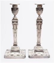 Sale 8590A - Lot 13 - A pair of good sterling silver neo classical style candlesticks with removable drip trays, BES CO, Birmingham, 1971, 1068g & 1089g,...