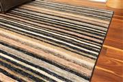 Sale 8904H - Lot 37 - An oversized woollen carpet in mute stripe design 302cm x 432cm