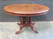 Sale 9031 - Lot 1024 - Victorian Walnut & Marquetry Loo Table, the oval top with burr centre & wide cross-banded edge, raised on a birdcage base (h:72 x w:...