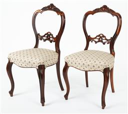 Sale 9123J - Lot 45 - A good condition pair of English antique rosewood chairs C: 1875. The waisted backs with a foliate crested top rail to a pierced car...