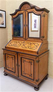 Sale 8550H - Lot 42 - A Scandinavian Biedermeier birdseye maple and ebony inlaid secretaire C: 1840, with an arched and mirror twin door top repurposed as...