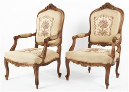 Sale 9123J - Lot 46 - A pair of antique French walnut arm chairs C: 1880. The shell and foliate top rail down to carved and upholstered arms. The back and...