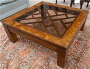 Sale 8595A - Lot 49 - A Chinese inspired walnut and square coffee table, the fretwork top with smoked glass panel, H 40 x 102 x 102cm