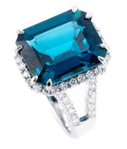 Sale 8899 - Lot 378 - AN 18CT WHITE GOLD TOPAZ AND DIAMOND COCKTAIL RING; featuring an emerald cut London blue topaz of approx. 6.35ct to surround gallery...