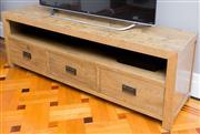 Sale 8575H - Lot 58 - A light oak entertainment/TV Unit,  with shelf and three drawers H: 60cm W: 180cm D: 45cm Villa,  03/2010 $1334