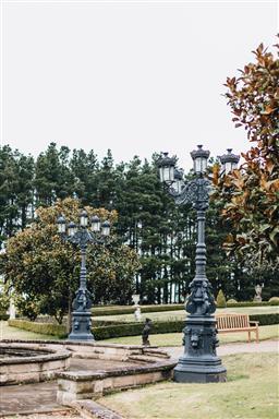 Sale 9200P - Lot 56 - A black painted Champs Elysée style cast iron light, Height 310cm