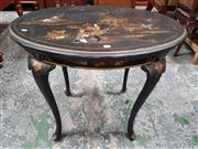Sale 8814 - Lot 1034 - Early 20th Century Black Chinoiserie Games Table, the removable oval top with garden scene, revealing a baize interior with carved w...