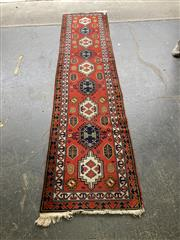 Sale 9068 - Lot 1006 - Vintage Caucasian Wool Runner, with alternating blue & white medallions on a red field (330 x 75cm)