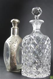 Sale 8586 - Lot 8 - Silver Plated Mounted Decanter And A Cut Crystal Example