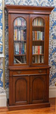 Sale 8649A - Lot 68 - A Victorian mahogany bookcase with two arched panel doors, long drawer and two timber panel drawers, H 212 x W 100 x W 45cm
