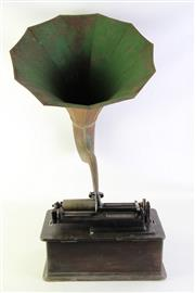 Sale 8940 - Lot 3 - An Edison Home Phonograph with rolls
