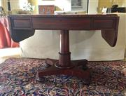 Sale 8550H - Lot 69 - An English antique Brazilian rosewood Regency sofa table C: 1820, with rare circle figuring to the top, the drop ends flanking the f...