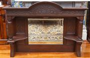 Sale 8649A - Lot 69 - An Edwardian carved oak over-mantle mirror with carved corners above a central mirror and shelf with turned columns, H 120 x W 157 x...