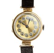 Sale 8414 - Lot 353 - CYMA 9CT GOLD LADYS VINTAGE WRISTWATCH; Arabic numeral telephone dial on a 15 jewell movement  to leather band, not working, case h...