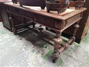 Sale 8814 - Lot 1058 - Late 19th/ Early 20th Century French Oak Desk, missing leather top, having three drawers & turned legs & stretcher base