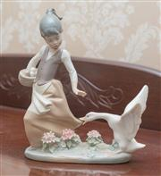 Sale 8375A - Lot 40 - A Lladro figure of girl chased by a goose. Height 21 cm