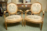 Sale 8392H - Lot 3 - A pair of French fauteuils of generous proportions with medallion back and floral tapestry upholstery, H 93 x W 63cm