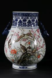 Sale 9015 - Lot 21 - A blue and white twin handled Chinese vase, decorated with butterflies and birds H: 29cm