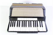 Sale 8977 - Lot 32 - A Cased Hohner Accordion-Some wear