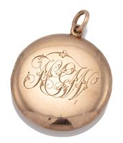 Sale 9066 - Lot 360 - AN ANTIQUE 15CT ROSE GOLD LOCKET PENDANT; 28.6mm round locket with monogrammed front opening to twin compartments, rear engraved 2n...