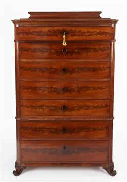 Sale 9123J - Lot 16 - A French antique walnut 2 part semainier C: 1900. The shaped and stepped top above a drawer with fitted compartments for jewellery o...