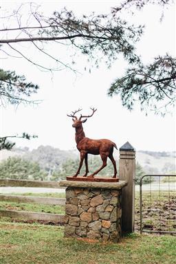 Sale 9200P - Lot 51 - A cast iron stag facing left, Height 146cm x  Width 102cm