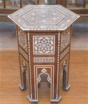 Sale 8368A - Lot 57 - A small Moorish hexagonal occasional table with mother of pearl inlay, W 29cm