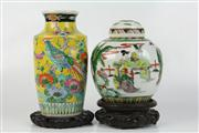 Sale 8422 - Lot 99 - Famille Jaune Vase with a Famille Verte Lidded Example (Both on Stands)