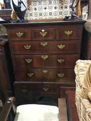 Sale 8714 - Lot 1060 - Early Georgian Style Walnut Chest on Chest, fitted with nine drawers and base with shaped apron