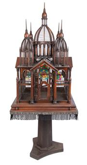 Sale 8599A - Lot 1 - A large and very impressive early 20th century ornate mahogany bird cage on stand. The central dome flanked by four smaller over fou...