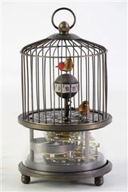 Sale 8935D - Lot 624 - A Birdcage Themed Clock Together with Another