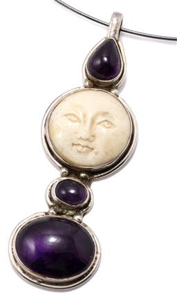 Sale 9149 - Lot 372 - A SHANO JEWELRY MAN IN THE MOON IVORY AND STONE SET PENDANT COLLAR; line drop of pear shape cabochon amethyst, carved mammoth ivory...