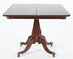 Sale 9123J - Lot 41 - An antique Regency mahogany swivel top tea table C: 1820. The opened top reveals a polished dining surface. The frieze carved to eac...