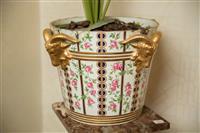 Sale 8392H - Lot 7 - A Paris porcelain enamelled pail with applied gilt ramshead decorations H 26cm x D 40cm (a/f) contains a faux fern