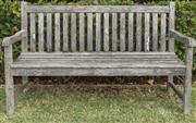 Sale 8575H - Lot 90 - A weathered teak garden bench H: 90cm W: 150cm