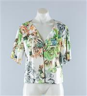 Sale 8800F - Lot 51 - A Howard Showers printed cotton blend box cut short sleeved top, as new with tags, size 14