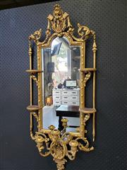 Sale 9031 - Lot 1013 - An Eclectic Style Gilt Wall Mirror Sconce, with four small attached shelves, surmounted by scroll work & three candle branches (smal...