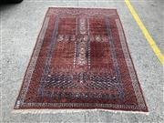 Sale 9068 - Lot 1095 - Vintage Afghan Princess Turkoman Wool Carpet, circa 1960, with divided field, in dark red tones (245 x 160cm)