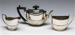 Sale 9138 - Lot 32 - A Small Early 20th Century, Hallmarked Sterling Silver Regency Style Tea Service. (W: of Teapot 21cm) (wt 397g)