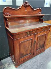 Sale 8657 - Lot 1007 - Victorian Mahogany Chiffonier, the carved back with shelf, above a single drawer & two panel doors