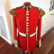 Sale 8878T - Lot 2 - British Coldstream Guards Tunic on Timber Stand, Height 127cm