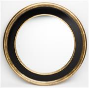 Sale 8651A - Lot 13 - An oval mirror finished in black and gold, diameter 75cm