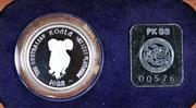 Sale 8679 - Lot 364 - 1988 AUSTRALIAN $50 KOALA SERIES PLATINUM PROOF COIN; 1/2 ounce .995 platinum coin in jarrah case, slight damage to case.