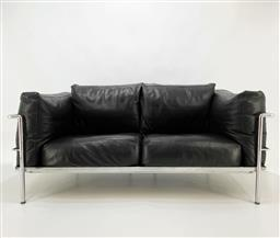 Sale 9252AD - Lot 5032 - LE CORBUSIER LC2 LEATHER 2-SEAT SOFA BY MOROSO, 1980s: polished chrome frame, original black leather upholstery with featherdown cus...